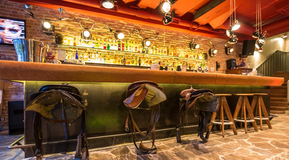 The saddles from the bar at Red Angus Steakhouse